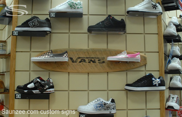 Saunzee signs displays for Sneaker wall display