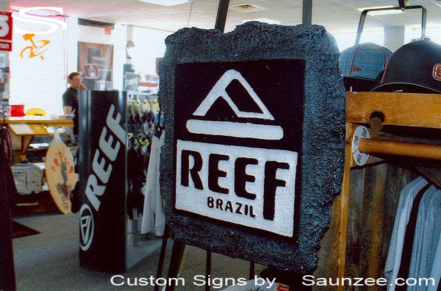 SAUNZEE Custom Signs Foam Molded Sign Foam Signs Makers of POP 3D Sign Marketing Sign Store Sign Advertising Signs SurfShop POP Displays In Store Rack Signage Coral Reel Look Sign Reef Brazil Sandals