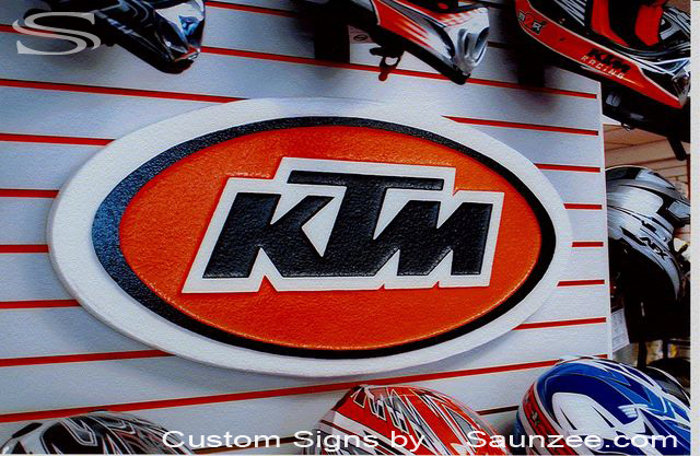 SAUNZEE Custom Signs Foam Molded Sign Foam Signs POP 3 Dimensional Signs 3D Sign Point of Purchase Marketing Advertising Signs POP Displays Production Signs Exhibiting at Trade Show Big Cool Signs Motocross Sign Moto Sign KTM PowerSport Signage
