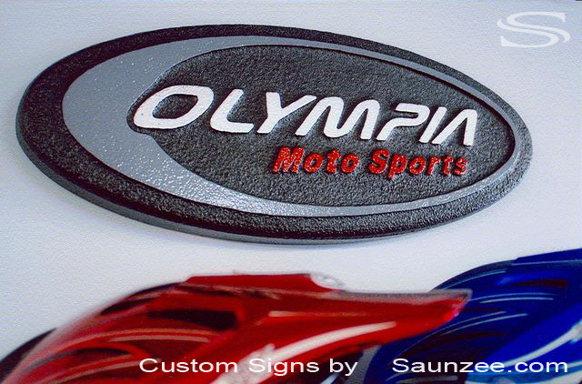 SAUNZEE Custom Signs Foam Molded Sign Foam Signs POP 3D Sign Point of Purchase Advertising Signs POP Displays Sign Makers Wall Sign Powersports industry Business Signage Dealer Expo Exhibit Sign Olympia Moto Sports