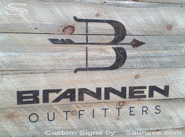 Saunzee Custom 3D Commercial Sign Makers Rustic Old Wood Rusty Metal Letters Nailed to Weathered Barn Wood Sign Stained Black Metal Sign Brannen Outfitters Company Business Signs