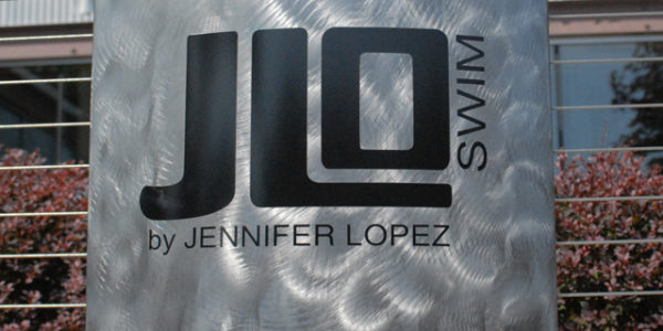 Saunzee-Brushed-Metal-sign_Brushed-Steel-Sign-Beach-Shop-Sign-Jennifer-Lopez-Signs-JLo-Signs-Swimwear-Signs